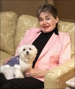 Leona Helmsley and Trouble, her Maltese dog.